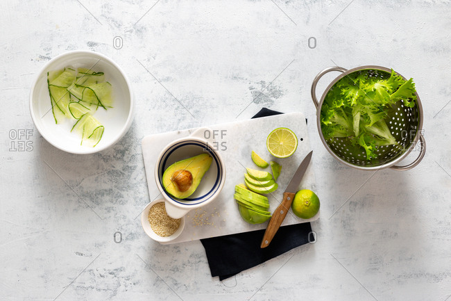 Cooking green diet avocado salad on a white background top view
