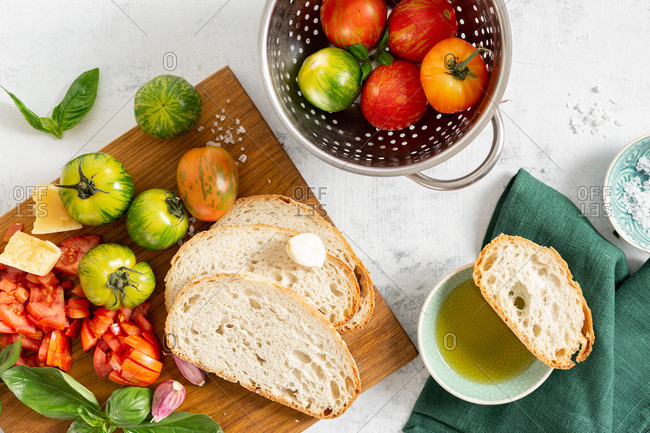 Ingredients for cooking Italian bruschetta with tomatoes