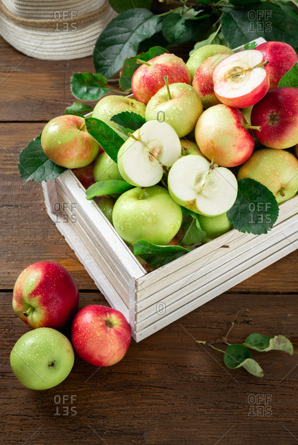 Wooden box with full of freshly picked apples