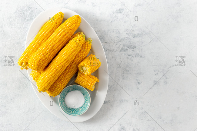 Boiled sweet corn with butter and chili pepper