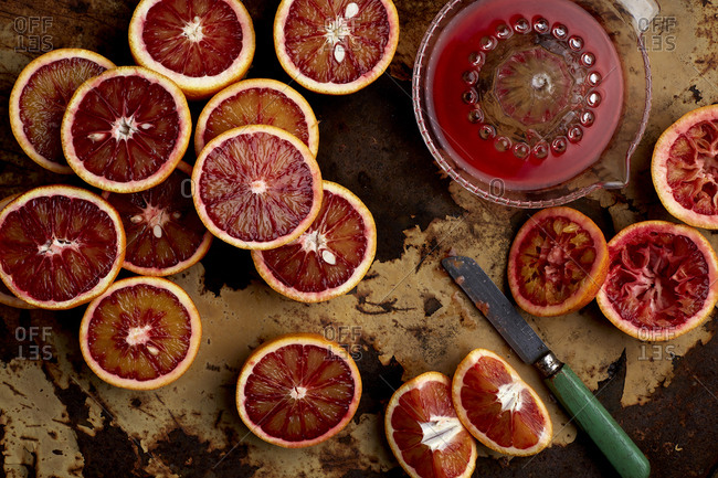 Blood Oranges being cut and squeezed