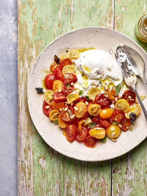 Buratta and tomato salad with sage, pine nuts and an olive oil dressing