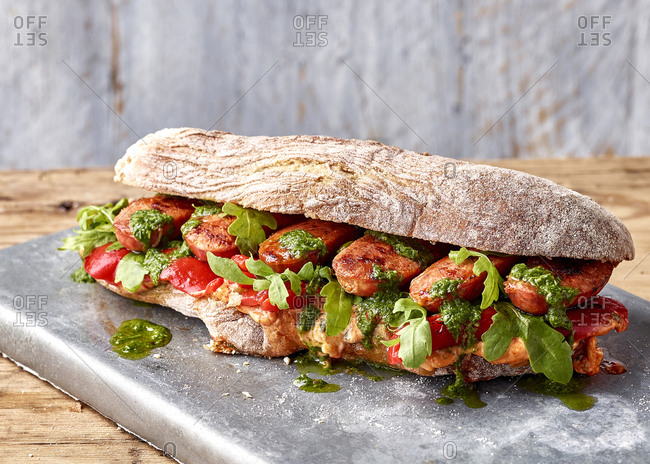 Chorizo ciabatta with roasted peppers, chimichurri, romesco mayo and rocket
