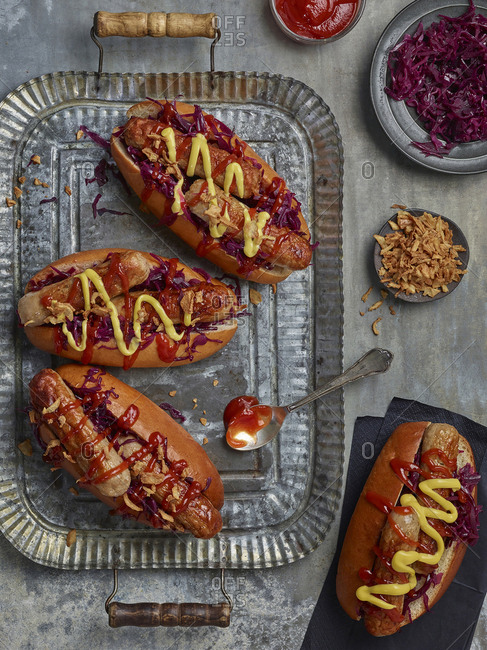 Winter hotdogs with spiced red cabbage, cripy onions, ketchup and mustard