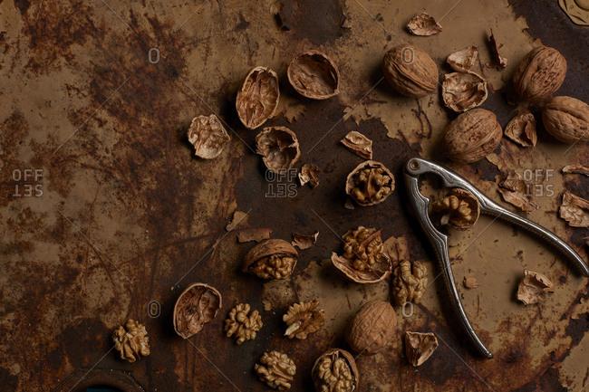 Walnuts bein broken on rusty metal surface