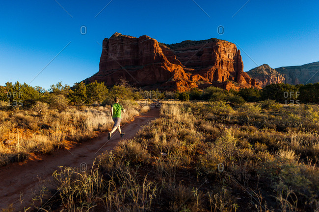 Man hiking on trail in the Courthouse Butte Loop Trail, Sedona, Arizona