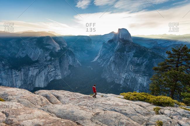 Man hiking on cliff, Yosemite National Park, California
