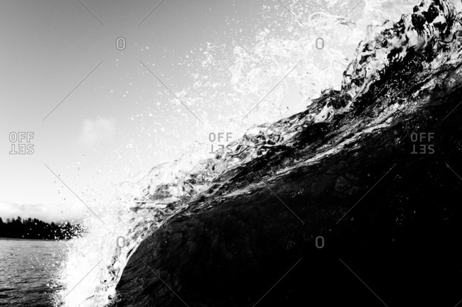 Crashing waves in the ocean in black and white