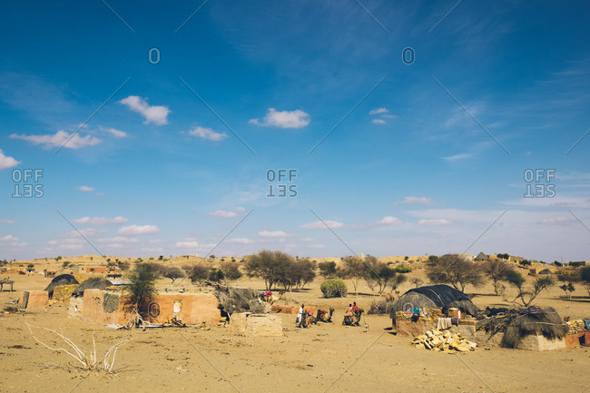 Thar Desert, India - February 21, 2019: Traditional huts in desert village