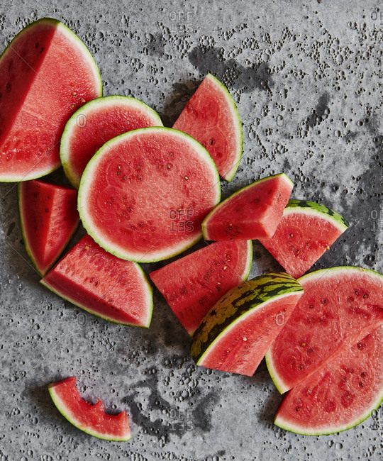 Watermelon wedges on a concrete background
