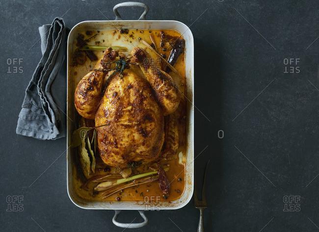 Roast chicken in a roasing tin