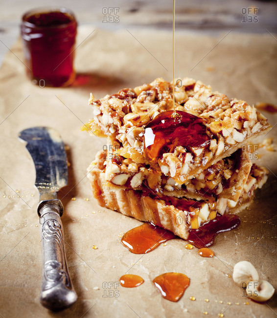 Nuts, maple syrup and honey caramel tart