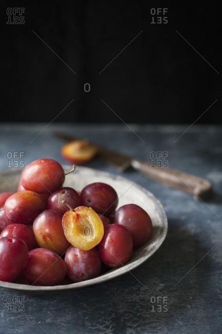 Still life of plums