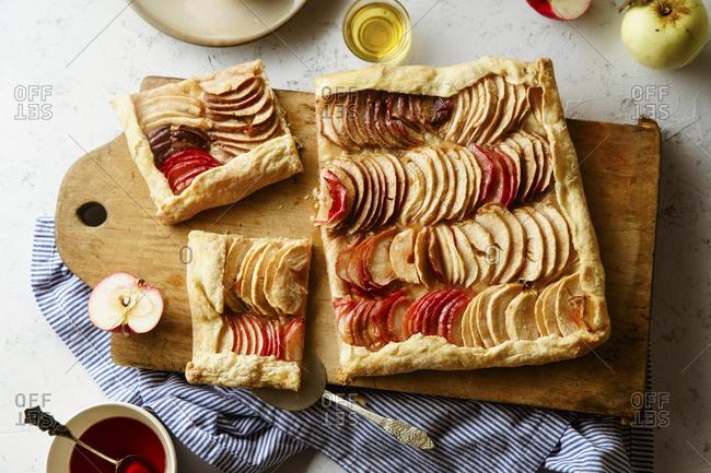 An apple tart with tahini frangipane and a hibiscus glaze