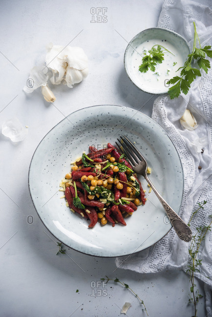 Beetroot orzo pasta with chickpeas, spinach and herb sauce (vegan)