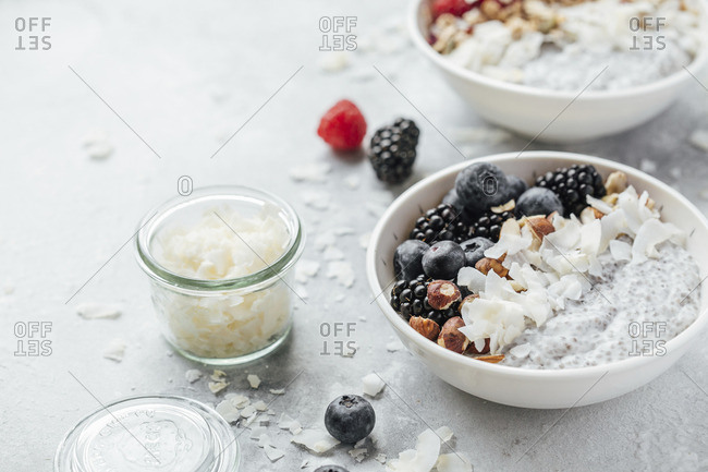 Chia pudding with coconut milk, berries and nuts
