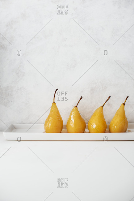 Poached pears, lined up
