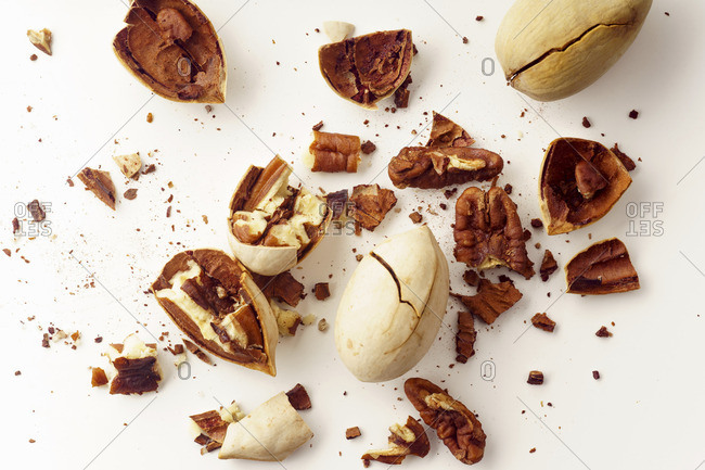 Cracked and opened pecan nuts and nuts in shell