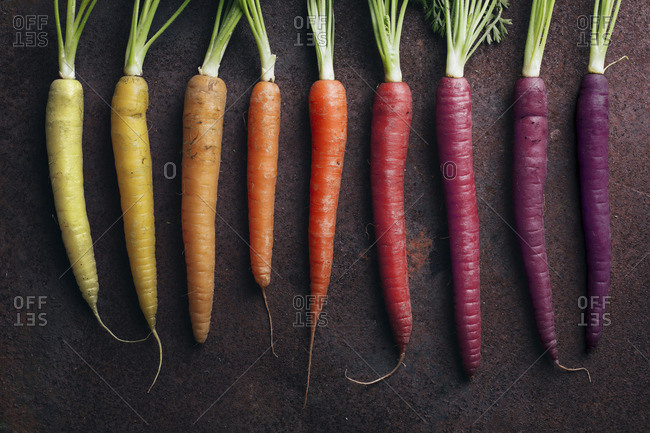 Colorful yellow, orange and purple carrots