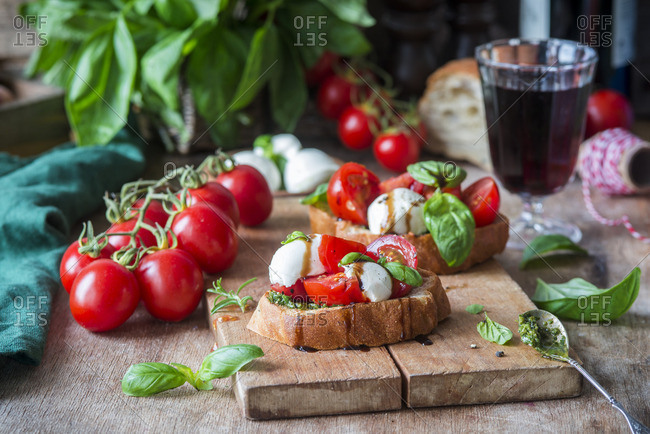 Bruschettas with mozzarella, tomatoes and pesto