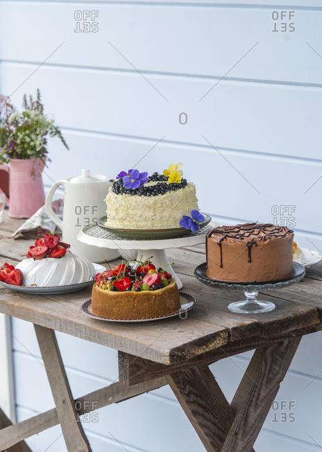 Chocolate cake, cheesecake with berries, whitechococolate blueberry cake and strawberry pavlova