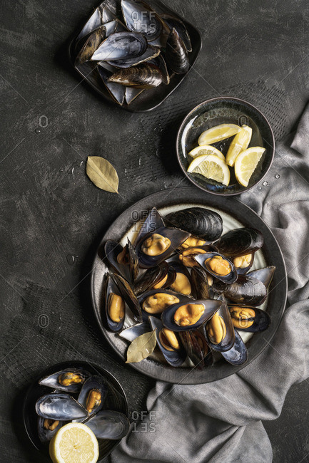 Fresh baked mussels served with lemon