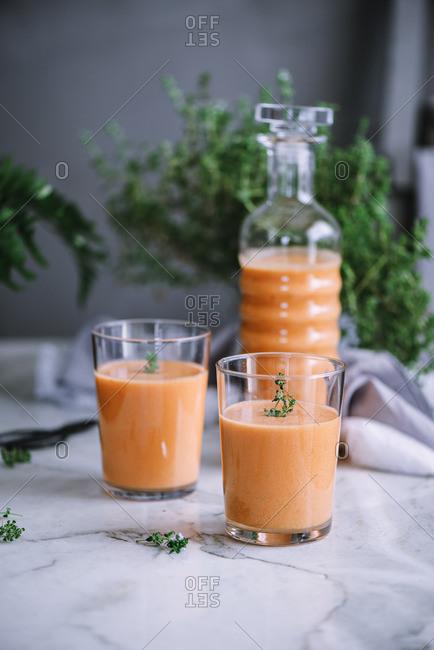 Bottle and glasses of fresh vitamin drink