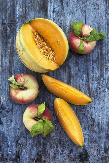 A still life with melon and peach