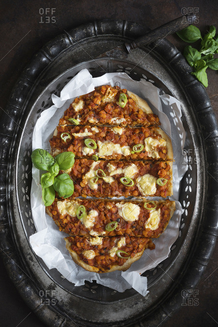 Vegan pizza with lentil bolognese and vegetable cheese (top view)