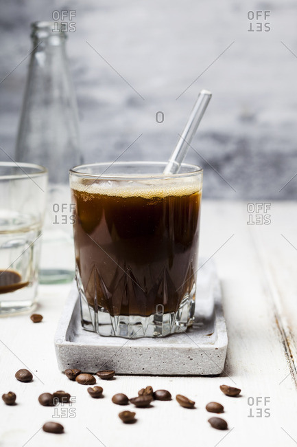 Espresso with sparkling water and ice cubes