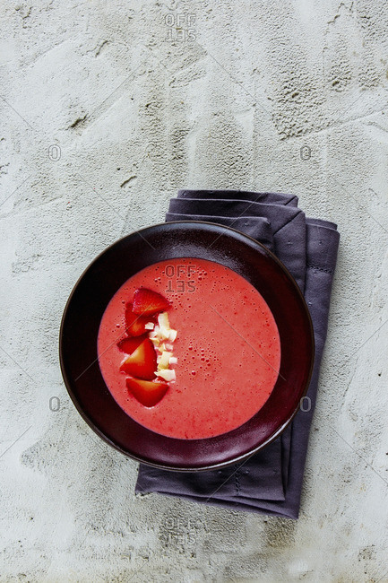 A strawberry smoothie in a bowl for breakfast (seen from above)