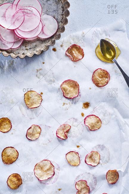 Roasted slices of radishes with honey