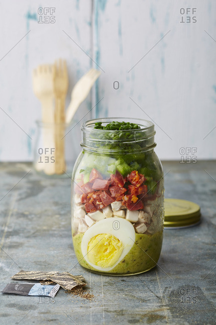 Layered salad with vegetables and egg in a jar