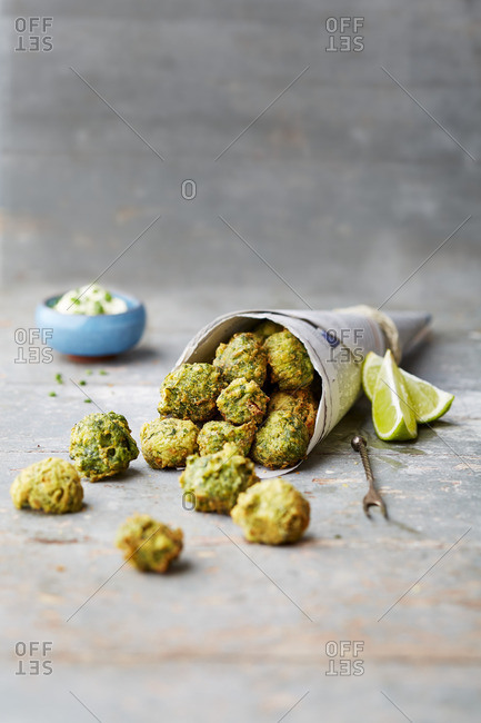 Baked spinach balls in a newspaper cone