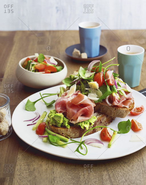 Country bread with avocado cream, Parma ham and cherry tomatoes