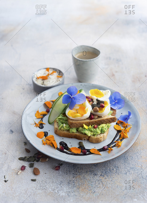 Toast with avocado pur�e, egg and cucumber