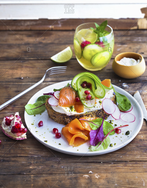 Bread with cream cheese, smoked salmon, cucumber and radishes