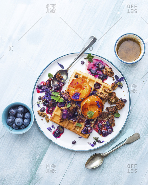 Waffles with roasted apricots and berry sauce