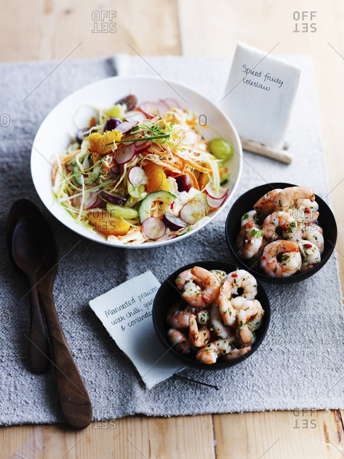 Fruity coleslaw and marinated prawns with chili and garlic