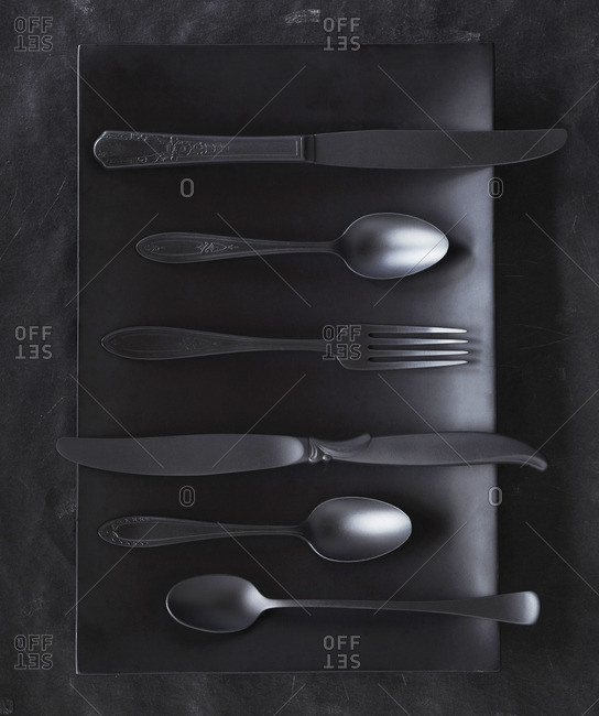 Vintage cutlery on a black surface