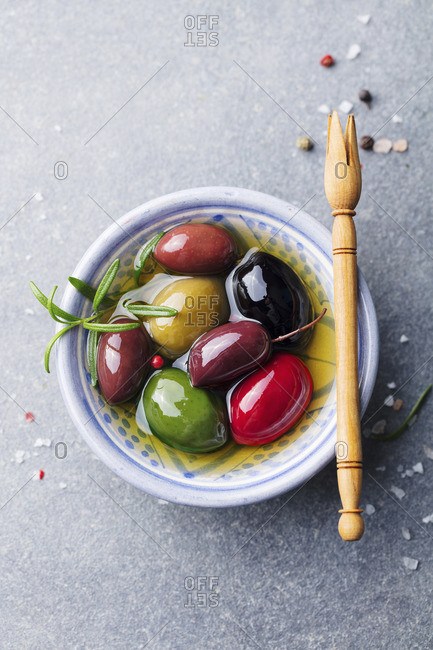 Olives assortment in bowl with oil