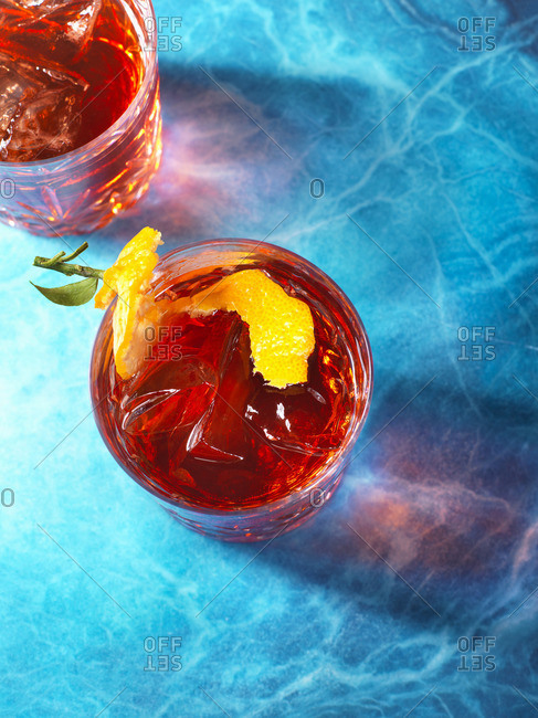 Negroni cocktails high angle on blue