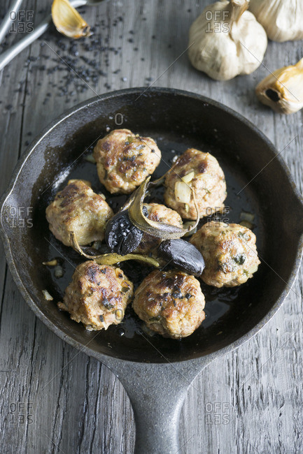 Meatballs with black garlic and sage