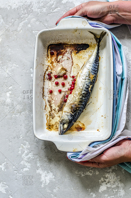 Fried mackerel in a baking dish