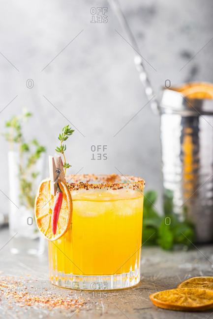 Refreshing summer citrus cocktail with orange, lemon juice and ice