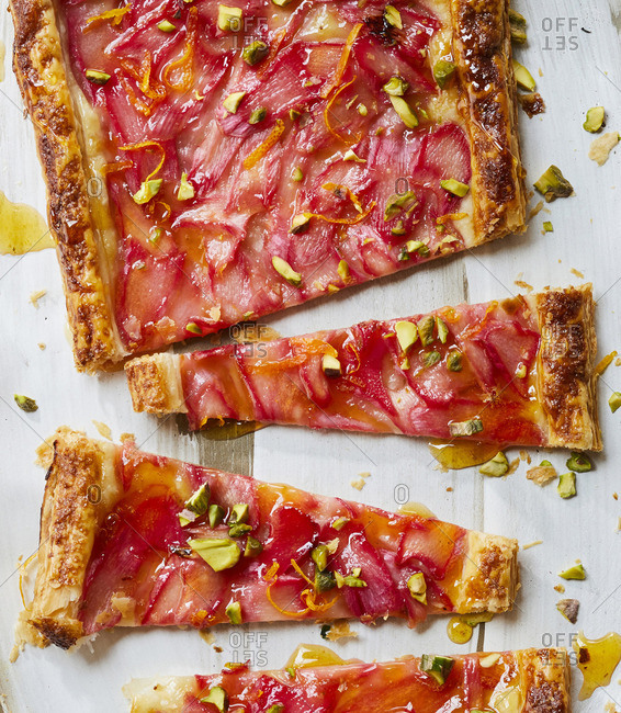 A rhubarb tart that has been cut up into pieces