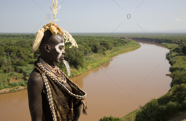 Omo Valley, Ethiopia - January 23, 2007: Karo tribe woman standing by river