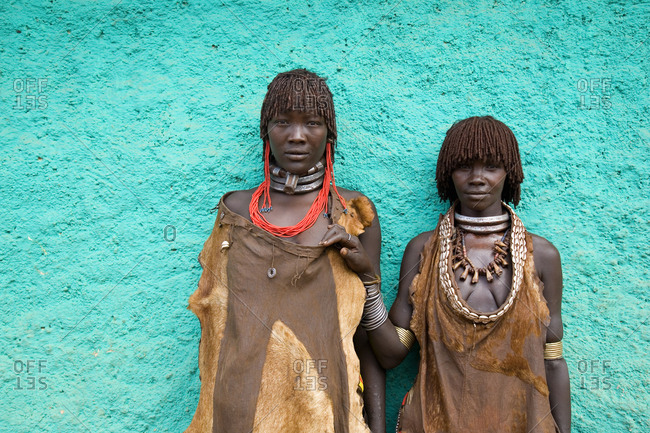 Omo Valley, Ethiopia - January 22, 2007: Two tribal girls from the Bena tribe wearing traditional clothing