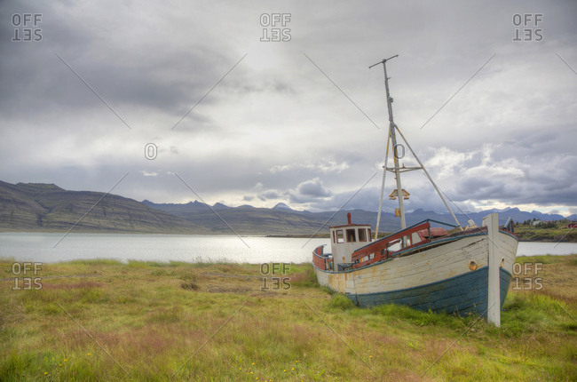 Old abandoned fishing boat converted for children to play on in the Eastern Region, Iceland
