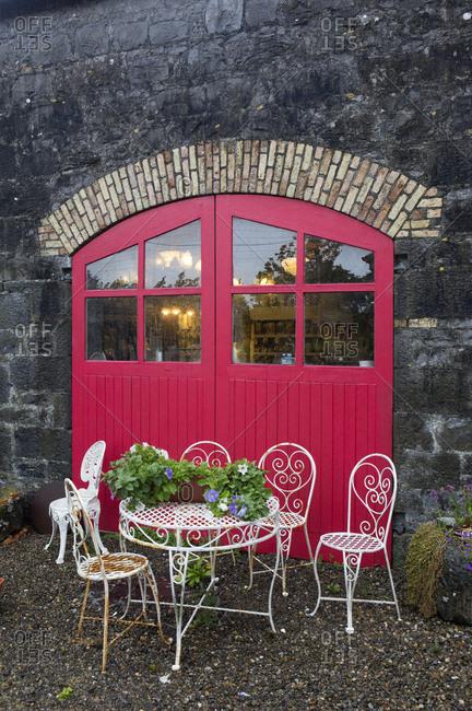 Limerick, Ireland - May 31, 2019: Red door into antique shop